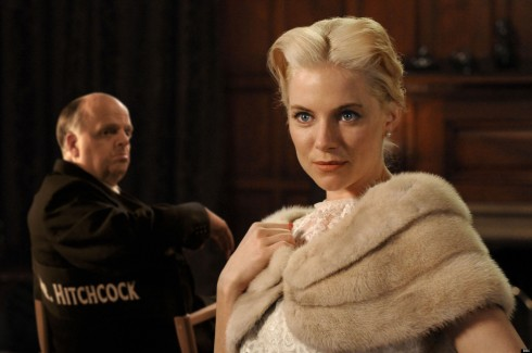 Programme Name: The Girl - TX: n/a - Episode: n/a (No. n/a) - Embargoed for publication until: n/a - Picture Shows: Alfred Hitchcock (TOBY JONES) and Tippi Hedren (SIENNA MILLER) in this biopic focusing on Hitchcock's relationship with Tippi Hedren  - (C) Wall to Wall - Photographer: David Bloomer